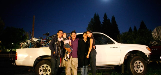 The Mejia family in front of a white pickup truck