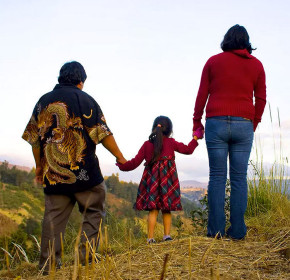 Part of the Mejia family looking across a field